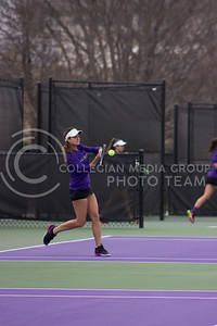 Sophomore Ana Navas starts a serve at the Mike Goss tennis stadiums on 3.17.17. (Kelly Pham   The Collegian)