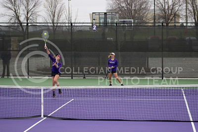 Freshman players Ines Mesquita and Meghan King take an advantage on the courts at the Mike Goss tennis stadiums on 3.17.30. (Kelly Pham | The Collegian)