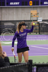 Sophomore player Millie Stretton awaits a serve at the Mike Goss tennis stadiums on 3.30.17 (Kelly Pham | The Collegian)