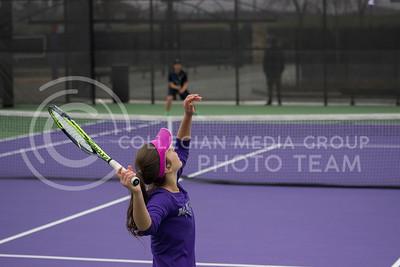 Freshman player Ines Mesquita serves the ball at the Mike Goss tennis stadiums on 3.30.17. (Kelly Pham   The Collegian)