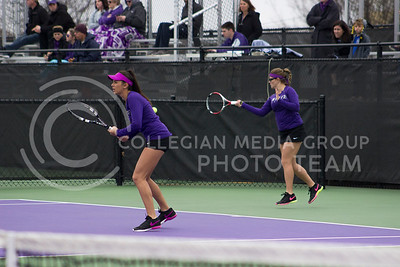 Senior players Iva Bago and Livia Cirnu defend the courts at Mike Goss tennis stadium on March 30, 2017. (Kelly Pham | The Collegian)