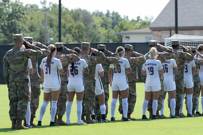 Fort Riley soldiers and Wildcats stand for the National Anthem. Sept 29, 2019. (Dylan Connell | Collegian Media Group)