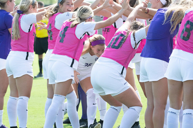 Mid-fielder Maddie Souder going through a tunnel made by her teammates before starting the game against the Texas Longhorns. Sept, 29, 2019,  (Dylan Connell | Collegian Media Group)