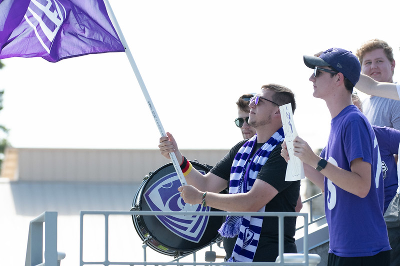 K-State fans gather around to show their support for the soccer team with flags and drums as they head against the Texas Longhorns. Sept 29, 2019, (Dylan Connell | Collegian Media Group)