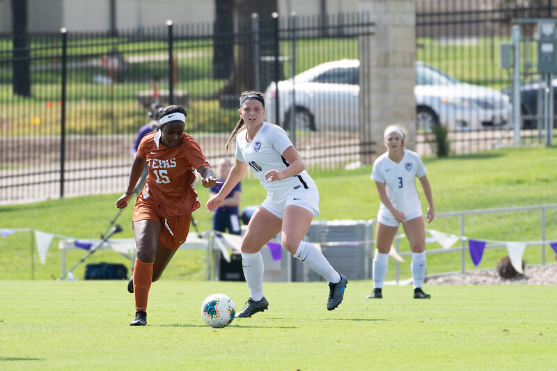 Forward Chloe Fisher attacking the Longhorns' CB Peyton Mcgee. Sept 29, 2019. (Dylan Connell | Collegian Media Group)