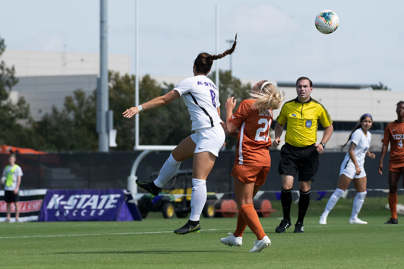 Brooklynn Entz heads the ball over Texans' midfielder, Kailey Smith, at K-State soccer stadium. Sept 29, 2019. (Dylan Connell | Collegian Media Group)