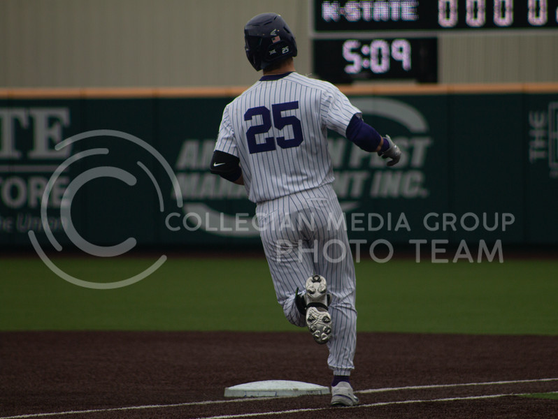 Freshman shortstop, Nick Goodwin tags first base on the K-State home field. K-State won 3-2 in the first game of their doubleheader against Oklahoma University on Saturday, April 17th. (Natalie Leonard l Collegian Media Group)