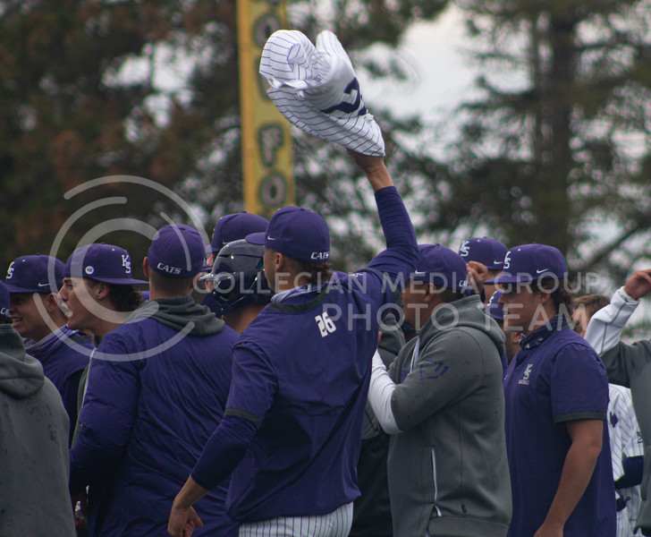 Junior right handed pitcher and outfielder, Chris Herb waves his jersey in the air in celebration. The team achieved a 3-2 victory in the first game of their double header at K-State against Oklahoma University on Saturday, April 17th. (Natalie Leonard l Collegian Media Group)