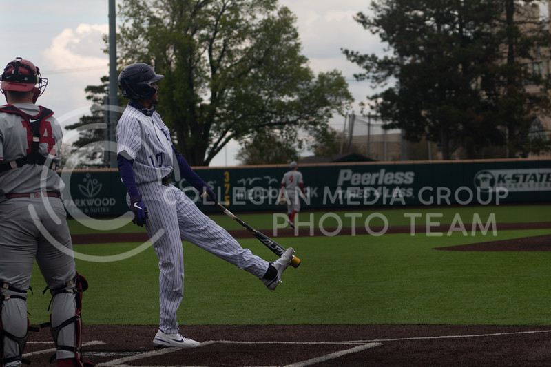 Redshirt junior and infielder, Kamron Willman warms up before batting from the Kansas State University home field. K-State won 3-2 in the first game of their doubleheader against Oklahoma University on Saturday, April 17th. (Natalie Leonard l Collegian Media Group)