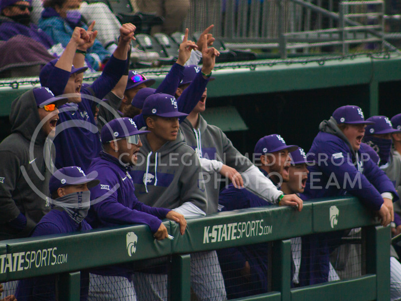 The Kansas State University baseball team cheers on their batter from the K-State dugout on Saturday, April 17th. They won 3-2 in the first game of their doubleheader against Oklahoma University. (Natalie Leonard l Collegian Media Group)
