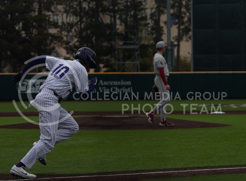 Redshirt junior and infielder, Kamron Willman runs to first base on the Kansas State University home field. K-State won 3-2 in the first game of their doubleheader against Oklahoma University on Saturday, April 17th. (Natalie Leonard l Collegian Media Group)