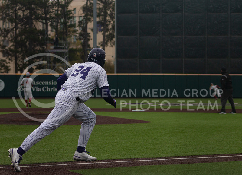Sophomore left handed pitcher and outfielder for Kansas State University, Dylan Phillips runs to first base after batting to win the first game of K-State's double header against Oklahoma University. His final bat led the team to a 3-2 victory in their home stadium on Saturday, April 17th. (Natalie Leonard l Collegian Media Group)