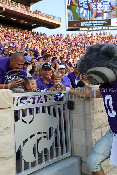 Willie shares a fist bump with a young Wildcats fan.