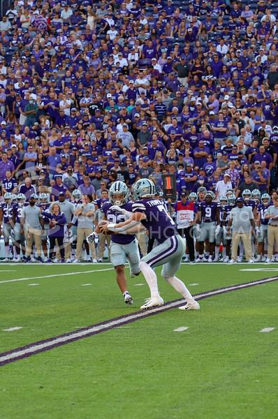Senior quarterback Skyler Thompson hands the ball to sophomore running back Deuce Vaughn during the Southern Illinois game on September 11, 2021.