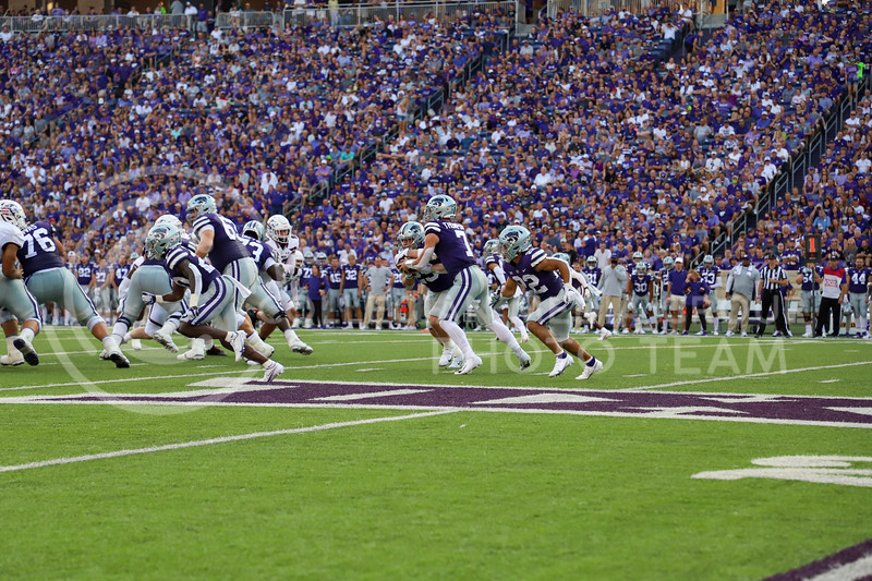 Senior quarterback Skyler Thompson hands the ball to sophomore wide receiver Gabe Hoover during the Southern Illinois game on September 11, 2021.