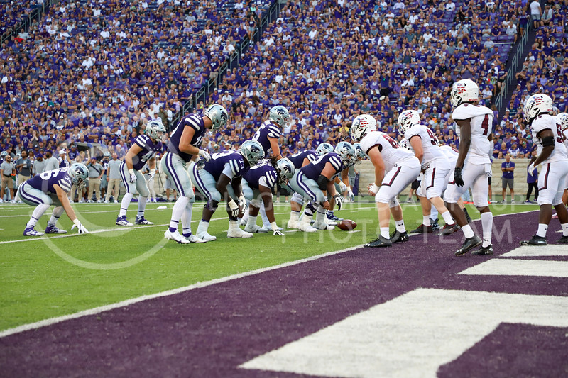 The offensive line prepares to run their play against Southern Illinois on Septenber 11, 2021.
