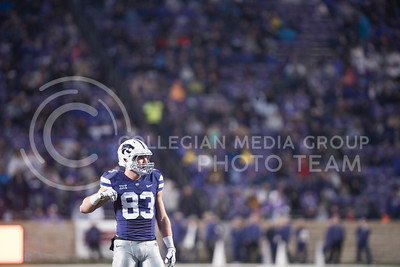 Kansas State Wildcat Number 83 Dalton Schoen scratches his armpit while he waits for the play to start at the homegame against the West Virginia Mountaineers, at Bill Snyder Family Stadium, in Manhattan, KS, on Nov. 11, 2017. (Olivia Bergmeier | Collegian Media Group)