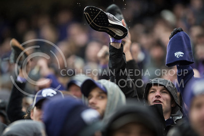 A Kansas State Fan cheers with his shoe for the Kansas State Wildcats at the football game against the West Virginia Mountaineers in Bill Snyder Family Stadium in Manhattan, KS, on Nov. 11, 2017. (Olivia Bergmeier | Collegian Media Group)