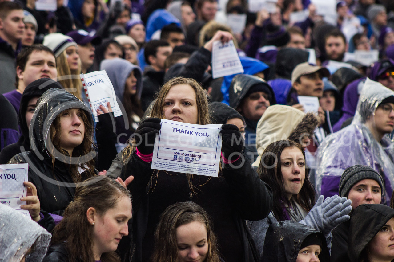 Kansas State Wildcat fans hold up signs thanking veterans at the game against the West Virginia Mountaineers at Bill Snyder Family Stadium, in Manhattan, KS, on Nov. 11, 2017. (Regan Tokos| Collegian Media Group)
