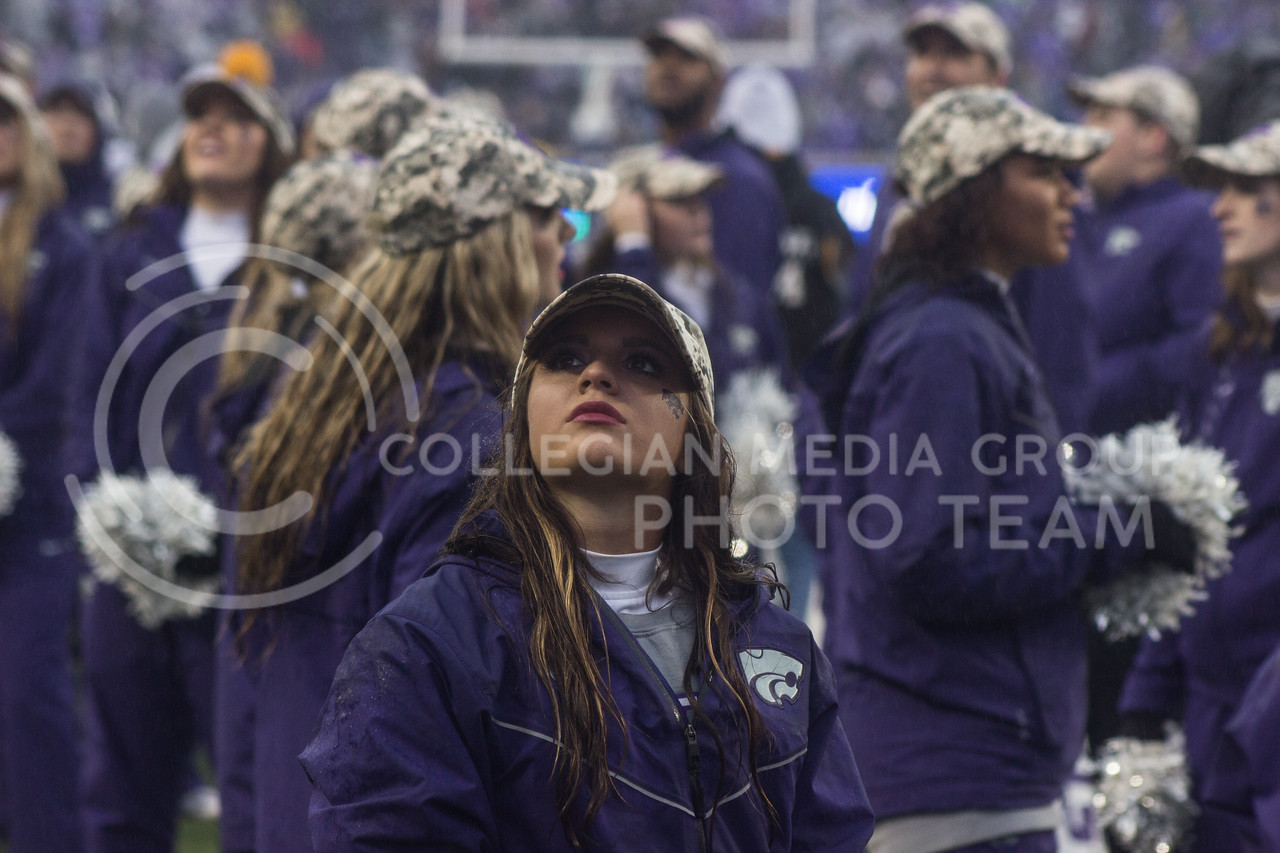 Kansas State Wildcat cheerleader watches a replay on the big screen at the game against the West Virginia Mountaineers at Bill Snyder Family Stadium, in Manhattan, KS, on Nov. 11, 2017. (Regan Tokos| Collegian Media Group)