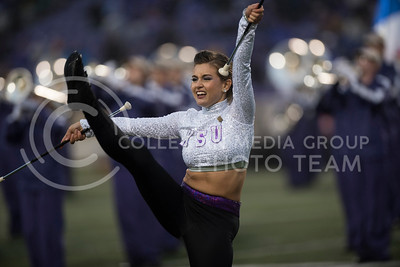A Kansas State Wildcat Twirler performs with the Kansas State Wildcat Pride Marching at Bill Snyder Family Stadium for the homegame against the West Virginia Mountaineers in Manhatttan, KS, on Nov. 11, 2017. (Olivia Bergmeier | Collegian media Group)