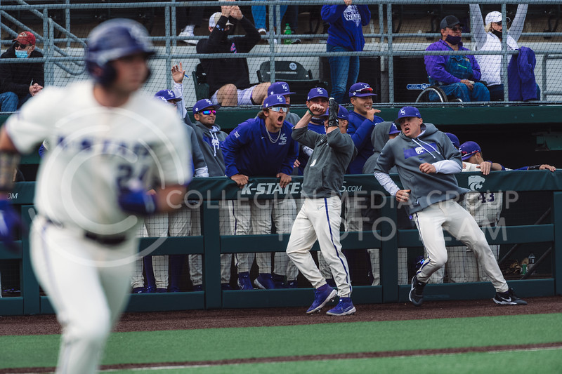 First baseman, Dylan Phillips, homered to right center and Wildcat's bench celebrates. Kansas State University baseball capped off the weekend by defeating Oklahoma 8-3 at Tointon Family Stadium, Manhattan KS. 4/18/21. (Dylan Connell | Collegian Media Group)