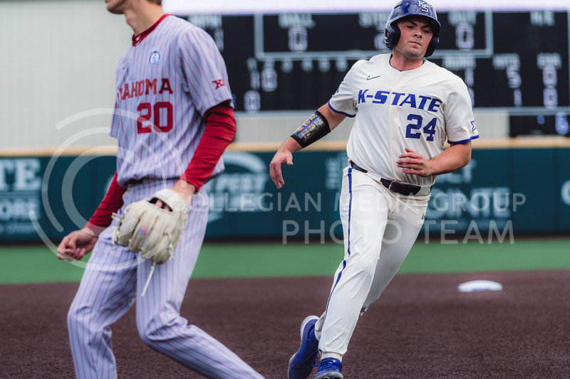 First baseman, Dylan Phillips, runs to home base after Chris Ceballos flied out to center field. Kansas State University baseball capped off the weekend by defeating Oklahoma 8-3 at Tointon Family Stadium, Manhattan KS. 4/18/21. (Dylan Connell | Collegian Media Group)