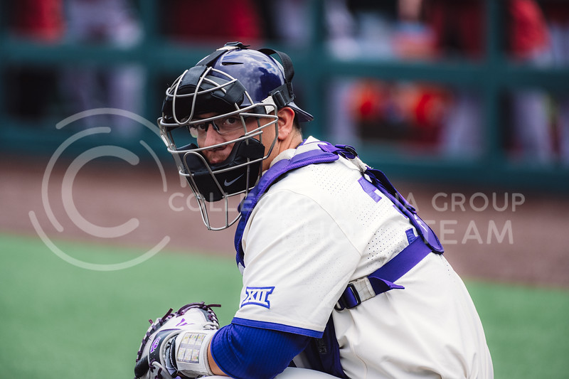 Wildcat's catcher, Chris Ceballos, eyes guidance from the coaches in the dugout. Kansas State University baseball capped off the weekend by defeating Oklahoma 8-3 at Tointon Family Stadium, Manhattan KS. 4/18/21. (Dylan Connell | Collegian Media Group)
