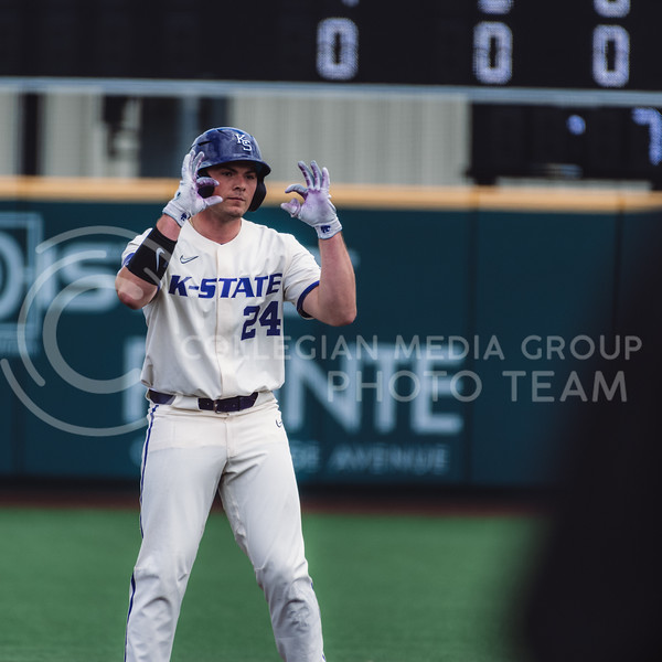 First baseman, Dylan Phillips, celebrates after hitting a double that then later turned into a score after Chris Ceballos flied out to center field. Kansas State University baseball capped off the weekend by defeating Oklahoma 8-3 at Tointon Family Stadium, Manhattan KS. 4/18/21. (Dylan Connell | Collegian Media Group)