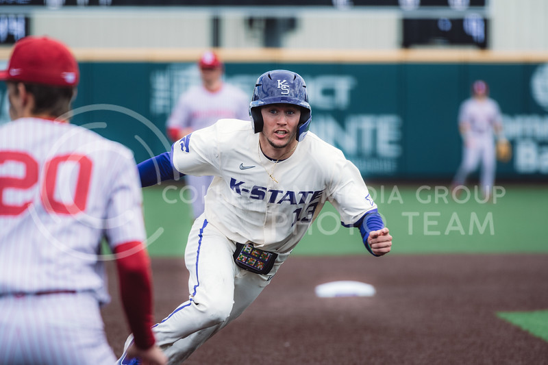 Wildcat's outfielder, Caleb Littlejim, runs to third base after a base hit. Kansas State University baseball capped off the weekend by defeating Oklahoma 8-3 at Tointon Family Stadium, Manhattan KS. 4/18/21. (Dylan Connell | Collegian Media Group)