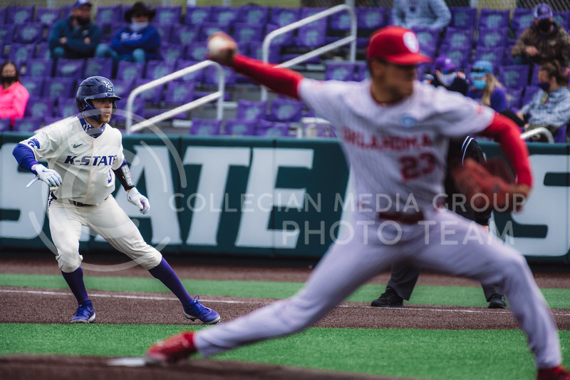 Wildcat's base runner, Cameron Thompson, lead off first base in preparation to steal to second. Kansas State University baseball capped off the weekend by defeating Oklahoma 8-3 at Tointon Family Stadium, Manhattan KS. 4/18/21. (Dylan Connell | Collegian Media Group)