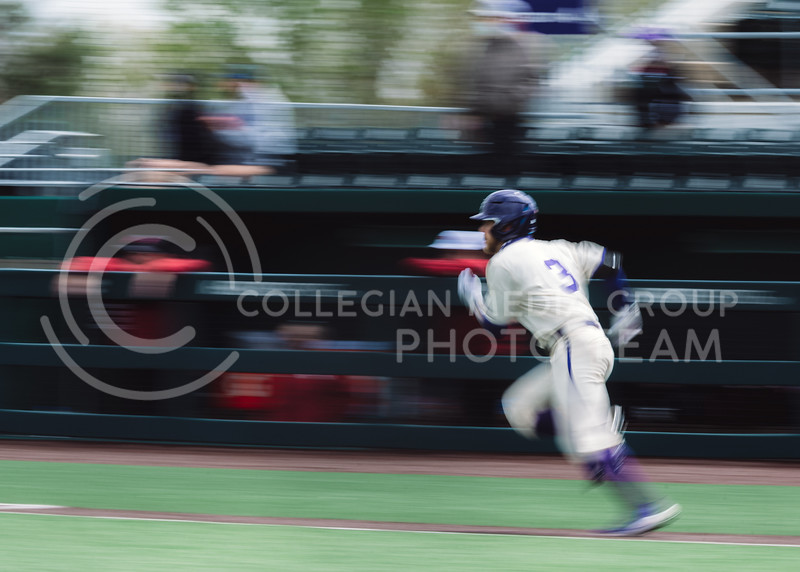 Wildcat's base runner, Cameron Thompson, runs to first base after a hit. Thompson finished the evening with one run. Kansas State University baseball capped off the weekend by defeating Oklahoma 8-3 at Tointon Family Stadium, Manhattan KS. 4/18/21. (Dylan Connell | Collegian Media Group)