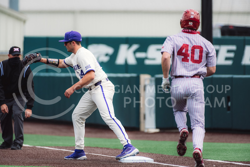 First baseman, Dylan Phillips, gets Oklahoma outfielder, Breydon Daniel, out after a hit. Kansas State University baseball capped off the weekend by defeating Oklahoma 8-3 at Tointon Family Stadium, Manhattan KS. 4/18/21. (Dylan Connell | Collegian Media Group)