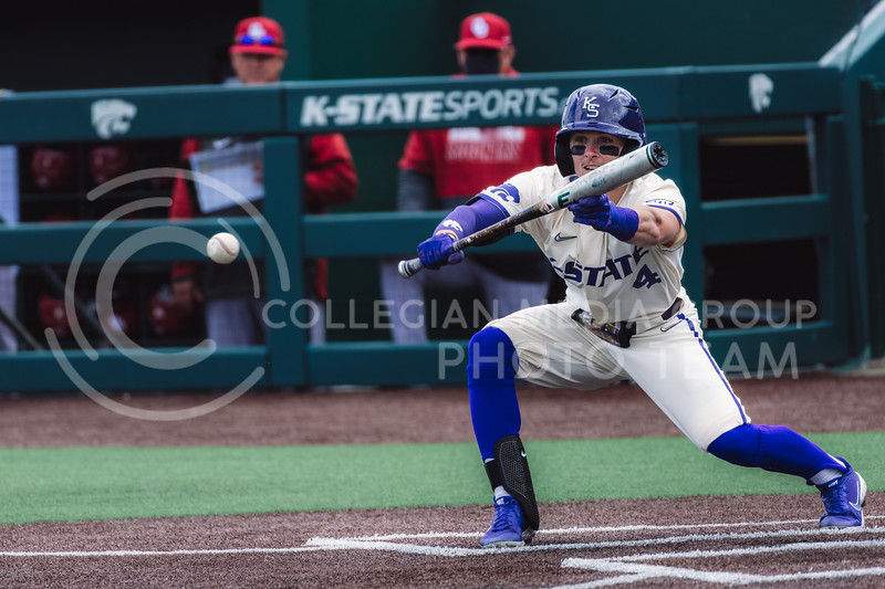 Wildcat's batter up, Blake Burrows, bunts the ball towards third base, giving the first base runner time to run to second. Kansas State University baseball capped off the weekend by defeating Oklahoma 8-3 at Tointon Family Stadium, Manhattan KS. 4/18/21. (Dylan Connell | Collegian Media Group)