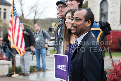 Kansas State Faculty members watch the crowd gather at the Anderson Greens for the KSUnite Rally in Manhattan, KS, on Nov. 14, 2017. (Olivia Bergmeier | Collegian Media Group)