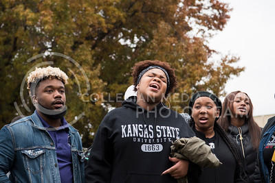 Black Student Union members sing before the KSUnite Rally begins at the Anderson Hall Greens at Kansas State University, in Manhattan, KS, on Nov. 14, 2017. (Olivia Bergmeier | Collegian Media Group)