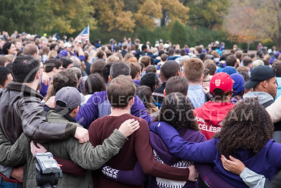 Kansas State University Students sing along to Kansas State Wildcat Pride Marching Band members playing the Kansas State Alma Mater for the KSUnite Rally at the Anderson Greens in Manhattan, KS, on Nov. 14, 2017. (Olivia Bergmeier | Collegian Media Group)