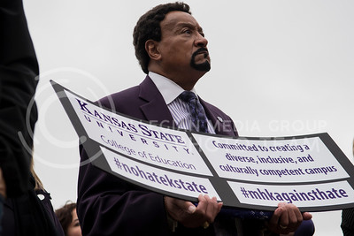 A faculty member from the Kansas State University College of Education represents their support at the KSUnite Rally at the Anderson Greens, in Manhattan, KS, on Nov. 14, 2017. (Olivia Bergmeier | Collegian Media Group)