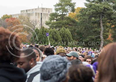 A #KSUnite sign is held up during the KSUnite Rally at the Anderson Greens at Kansas State University, in Manhattan, KS, on Nov. 14, 2017. (Olivia Bergmeier | Collegian Media Group)