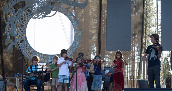 Ethan Lewis leading the Youth Arts Program performance on the Main Stage Sunday