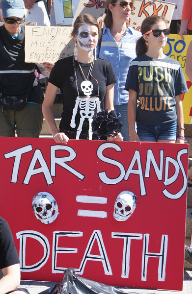 Young woman in skeleton make-up at anti KXL protest.