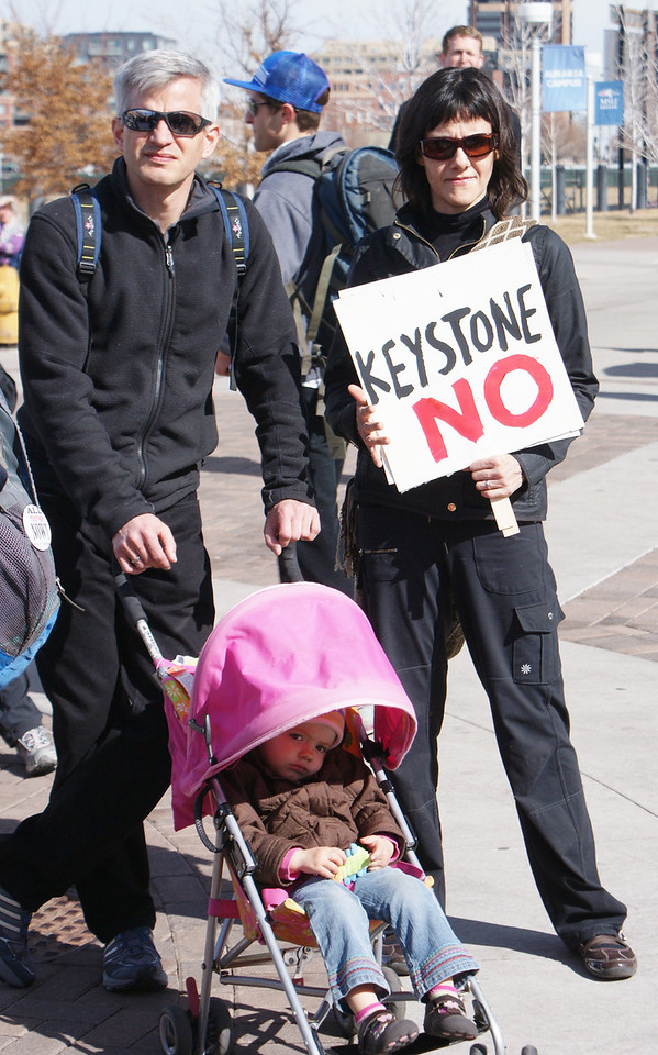 Parents and young child at anti KXL pipeline protest.