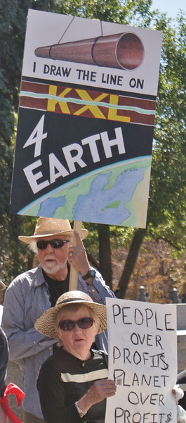 Senior man & woman at anti KXL protest.
