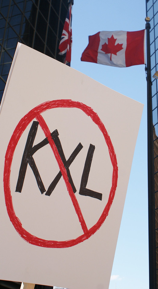 Anti KXL pipeline sign with Canadian flag in the background.