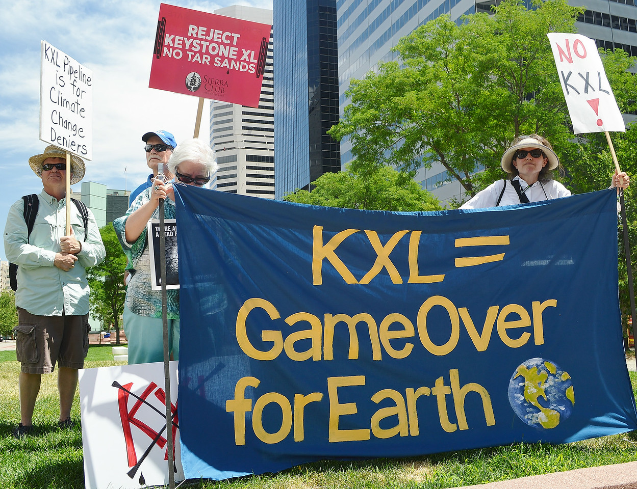 Group of KXL pipeline protesters standing behind banner.
