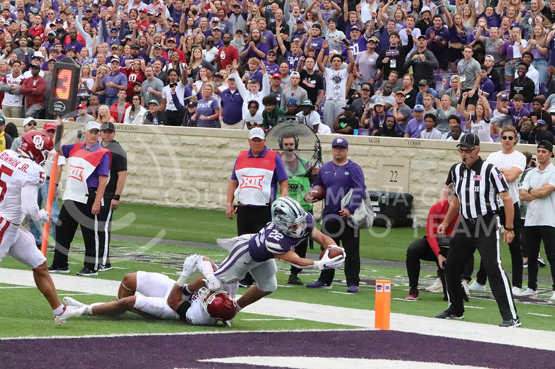 With his arms out, Sophomore Deuce Vaughn works to secure a touchdown during the Oklahoma University game on October 2, 2021. <br /> (Macey Franko   Collegian Media Group)