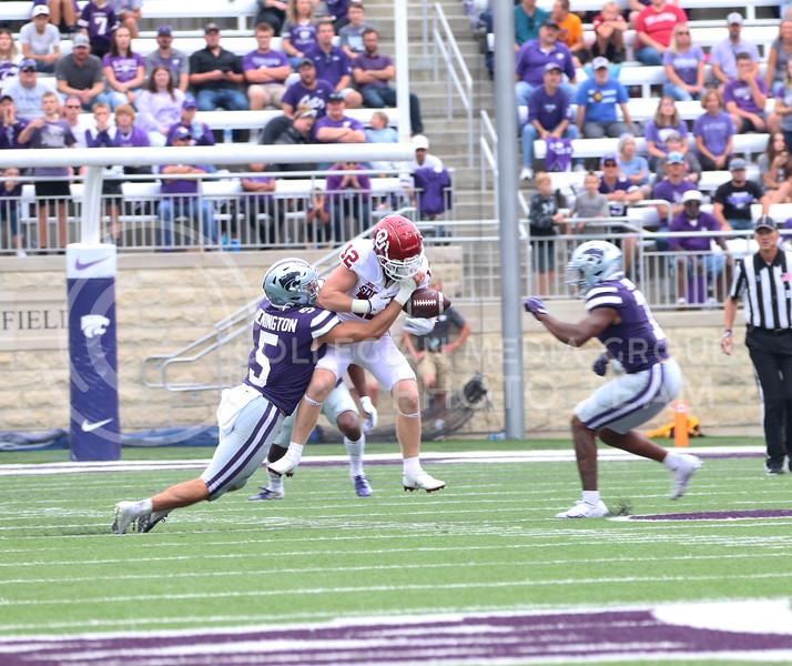 Tackling an OU receiver, Senior Ryan Henington strips the ball away in the Oklahoma University game on October 2, 2021. <br /> (Macey Franko   Collegian Media Group)