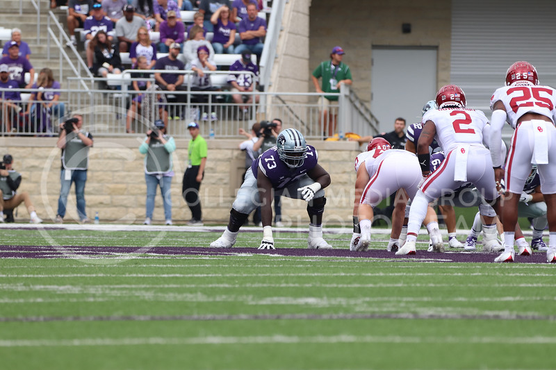 On the line of scrimmage, Junior Christian Duffie is ready for the play to begin in the Oklahoma University game on October 2, 2021. <br /> (Macey Franko   Collegian Media Group)