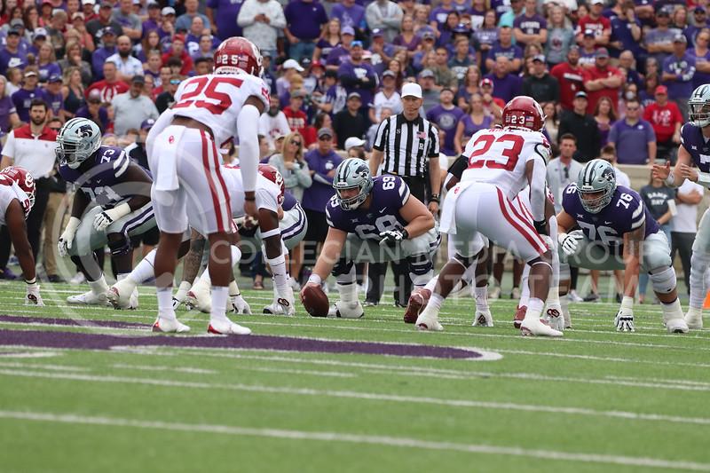 Preparing to snap the ball, Senior Noah Johnson stares down his opponent the Oklahoma University game on October 2, 2021. <br /> (Macey Franko   Collegian Media Group)