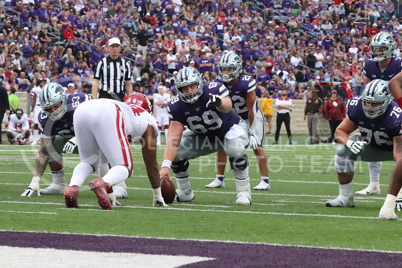 Calling out the defensive front, Senior Noah Johnson communicates with the offensive line in the Oklahoma University game on October 2, 2021. <br /> (Macey Franko   Collegian Media Group)